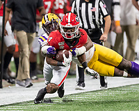 ATLANTA, GA - DECEMBER 7: James Cook #4 of the Georgia Bulldogs is tackled by Jay Ward #16 of the LSU Tigers during a game between Georgia Bulldogs and LSU Tigers at Mercedes Benz Stadium on December 7, 2019 in Atlanta, Georgia.