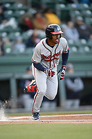 Center fielder Justin Dean (5) of the Rome Braves runs toward first in a game against the Greenville Drive on Saturday, April 20, 2019, at Fluor Field at the West End in Greenville, South Carolina. Rome won, 5-4. (Tom Priddy/Four Seam Images)