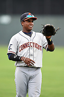 Connecticut Tigers second baseman Domingo Leyba (7) warms up before the first game of a doubleheader against the Batavia Muckdogs on July 20, 2014 at Dwyer Stadium in Batavia, New York.  Connecticut defeated Batavia 5-3.  (Mike Janes/Four Seam Images)