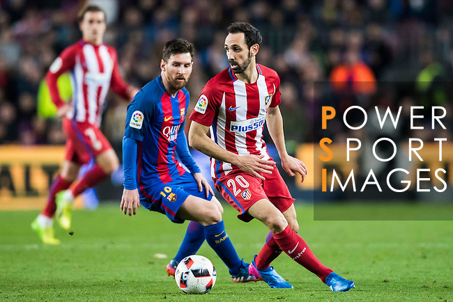 Lionel Andres Messi of FC Barcelona battles for the ball with Juan Francisco Torres Belen, Juanfran, of Atletico de Madrid during their Copa del Rey 2016-17 Semi-final match between FC Barcelona and Atletico de Madrid at the Camp Nou on 07 February 2017 in Barcelona, Spain. Photo by Diego Gonzalez Souto / Power Sport Images