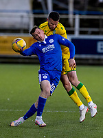 5th April 2021; Palmerston Park, Dumfries, Scotland; Scottish Cup Third Round, Queen of the South versus Hibernian; Paul McGinn of Hibernian  and Connor Shields of QOTS compete for  the ball