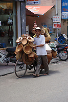 Hanoi<br /> , Vietnam - 2007 File Photo -<br /> <br /> <br />  bicycle seller for traditional hats. <br /> <br /> <br /> <br /> photo : James Wong-  Images Distribution