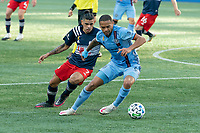 FOXBOROUGH, MA - SEPTEMBER 19: Alexander Callens #6 of New York City FC fends Gustavo Bou #7 of New England Revolution off as he protects the ball during a game between New York City FC and New England Revolution at Gillette on September 19, 2020 in Foxborough, Massachusetts.