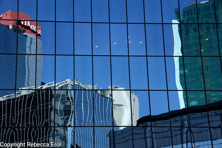 MODERN BUILDINGS REFLECTED IN A SKYSCRAPER, MASLAK, ISTANBUL, TURKEY