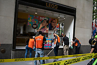 NEW YORK, NEW YORK - JUNE 2: Workers clean up after a night of looting on stores due to protest on June 2, 2020 in New York City. Protests spread across the country in at least 30 cities across the United States, over the death of unarmed black man George Floyd at the hands of a police officer, this is the latest death in a series of police deaths of black Americans. New York face it's second night of a curfew (Photo by Joana Toro / VIEWpress via Getty Images)
