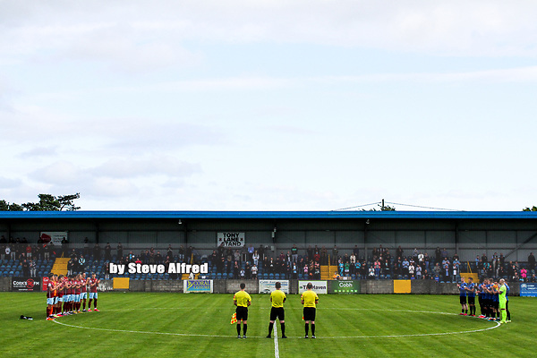 A minute's applause before kick off for past Cobh Ramblers captain and chairman John O'Rourke.<br /> <br /> Cobh Ramblers v Athlone Town, 7/8/21, SSE Airtricity League Division 1, St. Colman's Park, Cobh.<br /> Copyright Steve Alfred 2021.