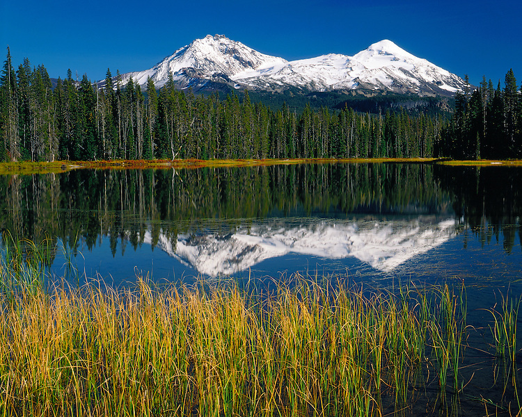 The North and Middle Sisters Mountains reflected in Scott Lake; Willamette National Forest, OR
