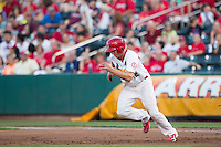 Stephen Piscotty (12) of the Springfield Cardinals takes off toward second base during a game against the Northwest Arkansas Naturals at Hammons Field on August 23, 2013 in Springfield, Missouri. (David Welker/Four Seam Images)