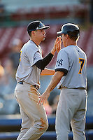 Trenton Thunder shortstop Tyler Wade (14) high fives manager Bobby Mitchell (7) after the first game of a doubleheader against the Hartford Yard Goats on June 1, 2016 at Sen. Thomas J. Dodd Memorial Stadium in Norwich, Connecticut.  Trenton defeated Hartford 4-2.  (Mike Janes/Four Seam Images)