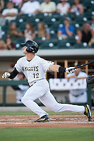 Adam Engel (12) of the Charlotte Knights follows through on his swing against the Scranton/Wilkes-Barre RailRiders at BB&T BallPark on July 20, 2016 in Charlotte, North Carolina.  The RailRiders defeated the Knights 14-2.  (Brian Westerholt/Four Seam Images)