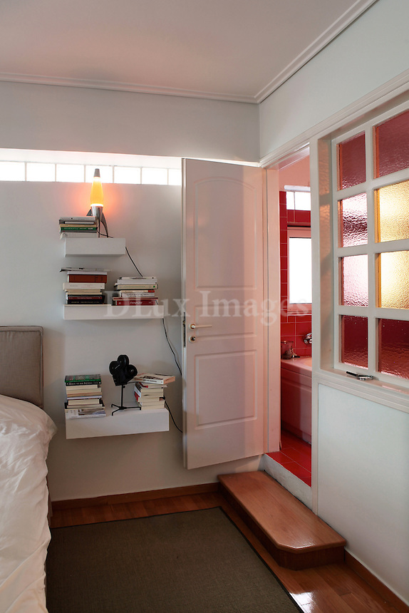 contemporary bedroom with private bathroom