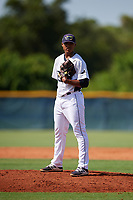 GCL Rays starting pitcher Taj Bradley (27) looks in for the sign during a game against the GCL Twins on August 9, 2018 at Charlotte Sports Park in Port Charlotte, Florida.  GCL Twins defeated GCL Rays 5-2.  (Mike Janes/Four Seam Images)