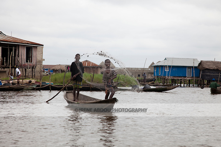 """Ganvie, Benin, with some 3,000 stilted buildings and a population of 20,000-30,000 people, may be the largest """"lake vllage"""" in Africa.  In Ganvie, the population lives exclusively from fishing, building houses on stilts in and next to Lake Nokoue.  Because the Dan-Homey religion prohibited attacks on communities living in the water, the village of Ganvie dates back to the 16th or 17th century, when it was built to protect people from slavery."""