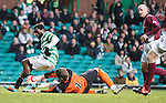 Celtic's Ibrahim Rabiu fails to take the ball past Arbroath keeper Scott Morrison who grabs at his legs