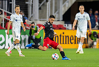 WASHINGTON, DC - MAY 13: Junior Moreno #5 of D.C. United takes a shot during a game between Chicago Fire FC and D.C. United at Audi FIeld on May 13, 2021 in Washington, DC.