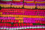 More than a thousand sheets of cloth create a rainbow of colours as workers lay them out to dry under the sun.  A sea of red, orange, pink, purple and yellow can be seen in these aerial shots as the fabric dries in a field in Narayanganj, Bangladesh.<br /> <br /> Workers can also be seen in the middle of the palette of colour as they unfold each sheet. Once the cloth dries it is used to create traditional Bangladeshi women's dresses.  Freelance photographer Azim Khan Ronnie, 34 and from Dhaka in Bangladesh, often visits to watch and take photos of the fabrics drying.  SEE OUR COPY FOR DETAILS.<br /> <br /> Please byline: Azim Khan Ronnie /Solent News<br /> <br /> © Azim Khan Ronnie /Solent News & Photo Agency<br /> UK +44 (0) 2380 458800