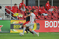 WASHINGTON, DC - SEPTEMBER 12: Ola Kamara #9 of D.C. United battles for the ball with Aaron Long #33 of New York Red Bulls during a game between New York Red Bulls and D.C. United at Audi Field on September 12, 2020 in Washington, DC.