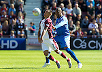 Hearts v St Johnstone...14.08.10  .Suso Santana gets a shove in the back by Michael Duberry.Picture by Graeme Hart..Copyright Perthshire Picture Agency.Tel: 01738 623350  Mobile: 07990 594431