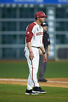 Nate Thompson (30) of the Arkansas Razorbacks coaches third base during the game against the Baylor Bears in game nine of the 2020 Shriners Hospitals for Children College Classic at Minute Maid Park on March 1, 2020 in Houston, Texas. The Bears defeated the Razorbacks 3-2. (Brian Westerholt/Four Seam Images)