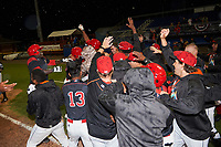 Batavia Muckdogs Thomas Jones (49) is mobbed by teammates after drawing a bases loaded game winning walk in the bottom of the tenth inning during a game against the West Virginia Black Bears on June 26, 2017 at Dwyer Stadium in Batavia, New York.  Batavia defeated West Virginia 1-0 in ten innings.  (Mike Janes/Four Seam Images)