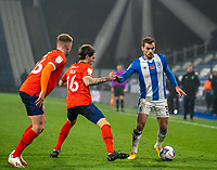 7th November 2020 The John Smiths Stadium, Huddersfield, Yorkshire, England; English Football League Championship Football, Huddersfield Town versus Luton Town; Harry Toffolo of Huddersfield Town on the ball with Glen Rea of Luton Town  and James Bree of Luton Town  tracking him