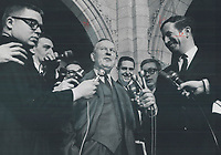 After his victory in the House of Commons, in which government won confidence vote 138-119, Prime Minister Pearson talks with newsmen outside Parliament in Ottawa.