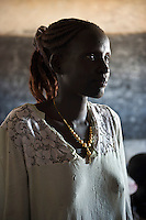 A young woman living in a temporary shelter.