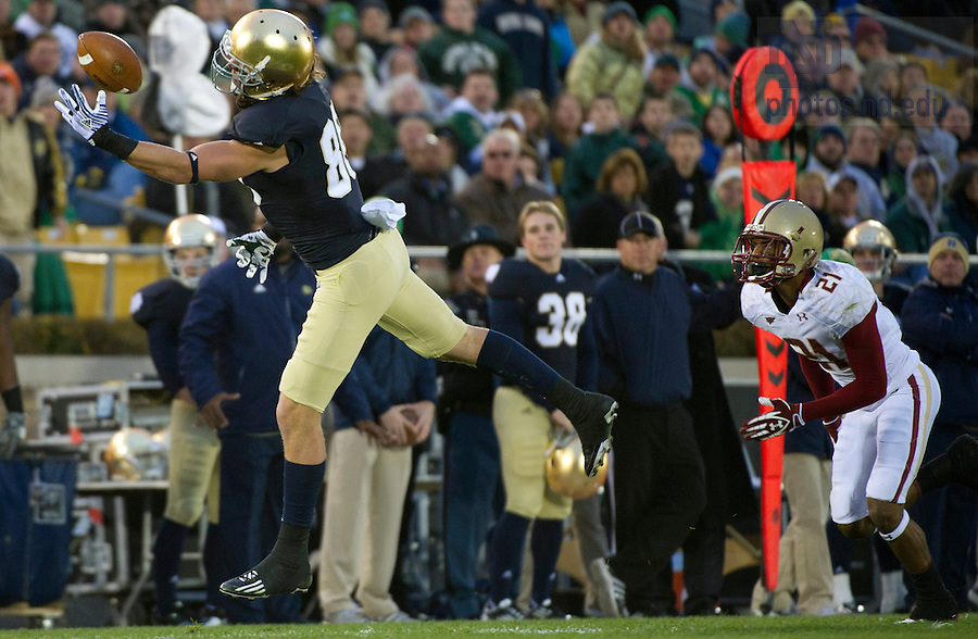 November 19, 2011; Notre Dame Fighting Irish tight end Tyler Eifert (80) makes a 38-yard reception as Boston College Eagles defensive back Manny Asprilla (21) looks on during the first quarter. Photo by Barbara Johnston/University of Notre Dame.