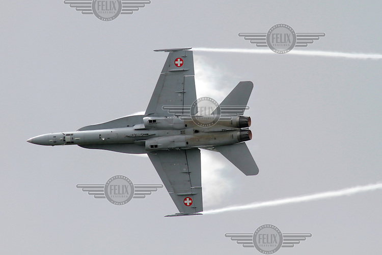A Swiss F-18 Hornet gives an air display during Tiger Air show.  Nato Tiger Meet is an annual gathering of squadrons using the tiger as their mascot. While originally mostly a social event it is now a full military exercise. Tiger Meet 2012 was held at the Norwegian air base Ørlandet.