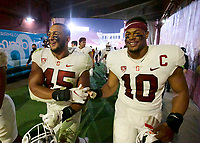 LOS ANGELES, CA - SEPTEMBER 11: Ricky Miezan #45 and Jordan Fox #10 of the Stanford Cardinal shake hands in the tunnel after a game between University of Southern California and Stanford Football at Los Angeles Memorial Coliseum on September 11, 2021 in Los Angeles, California.