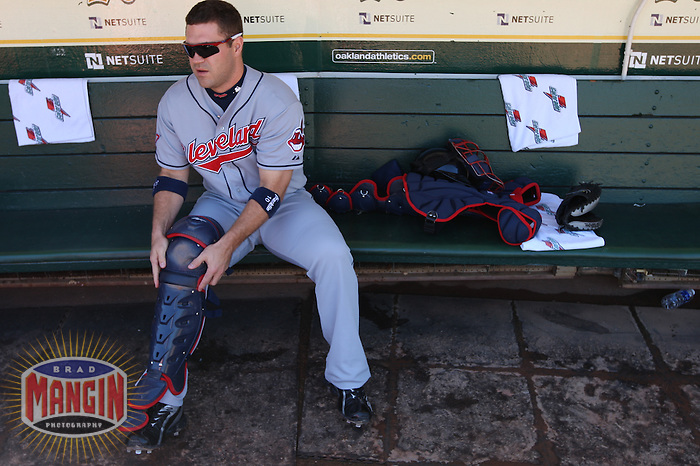 OAKLAND, CA - SEPTEMBER 19:  Kelly Shoppach #10 of the Cleveland Indians gets ready in the dugout before the game against the Oakland Athletics at the Oakland-Alameda County Coliseum on September 19, 2009 in Oakland, California. Photo by Brad Mangin