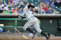 Paulo Orlando #16 of the Omaha Storm Chasers heads to first base against the Iowa Cubs at Principal Park on July 2, 2014 in Des Moines, Iowa. The Cubs  beat Storm Chasers 4-3.   (Dennis Hubbard/Four Seam Images)