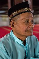 Yogyakarta, Java, Indonesia.  Man Awaiting Noon Prayers, Great Mosque, Masjid Gedhe Kauman, mid-18th. Century.