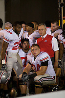 06 October 2007: Ohio State head coach Jim Tressel..The Ohio State Buckeyes defeated the Purdue Boilermakers 23-7 at Ross-Ade Stadium, West Lafayette, Indiana.  Pictured just prior to game time are Head Coach Jim Tressel along with players Chris Wells (28), Daniel Dye (middle) and an emotional Kirk Barton (seated).