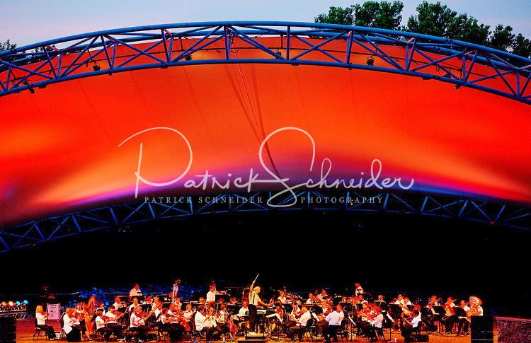 The Charlotte Symphony 2011 Summer Pops season outdoor concerts at Symphony Park, in Charlotte's SouthPark Mall area has continued as a beloved Charlotte tradition since 1983. Symphony Park is located behind SouthPark mall at 4400 Sharon Road, Charlotte, NC.   The Charlotte Symphony Orchestra is one of the largest and most-active professional performing arts organizations in the Carolinas. Contact Patrick Schneider Photography to see other photographs of Charlotte NC lifestyle