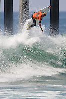 Aussie Mick Fanning begins his ascent on an air section during round of 96 of the 2010 US Open of Surfing in Huntington Beach, California on August 4, 2010.