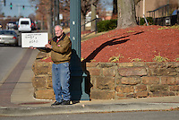 STAFF PHOTO BEN GOFF  @NWABenGoff -- 11/25/14 Don Preece holds a sign reading 'Darren Wilson of Ferguson is a hero' across the street from a protest organized by the OMNI Center for Peace, Justice & Ecology in front of the Washington County Courthouse in Fayetteville on Tuesday Nov. 25, 2014. The Omni Center demonstration was in response to the decision Monday night by the St. Louis County grand jury not to indict police officer Darren Wilson, who fatally shot Michael Brown in Ferguson, Mo.