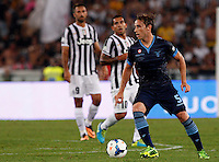 Calcio, Supercoppa di Lega: Juventus vs Lazio. Roma, stadio Olimpico, 18 agosto 2013<br /> Lazio midfielder Lucas Biglia, of Argentina, in action during the Italian League Supercup football final match between Juventus and Lazio, at Rome's Olympic stadium,  18 August 2013.<br /> UPDATE IMAGES PRESS/Riccardo De Luca