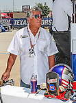 Mario Andretti watches the action during qualifying for the IZOD Indycar Firestone 550 race at Texas Motor Speedway in Fort Worth,Texas. IZOD Indycar driver Alex Tagliani (98) driver of the Team Barracuda-BHA car qualifies in the top spot during the Firestone 550 race...