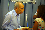 Israeli President Shimon Peres blows a candle during his 84th birthday celebration at his residance in Jerusalem Sunday Aug 5 2007. Photo by Eyal Warshavsky