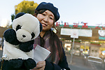 A visitor arrives to see the new giant panda cub Xiang Xiang at Tokyo's Ueno Zoo on December 19, 2017, Tokyo, Japan. The new female panda cub Xiang Xiang, born June 12, 2017, is being shown to the public for the first time. More than one thousand visitors are expected to come to see the panda on the day of her public debut. (Photo by Rodrigo Reyes Marin/AFLO)