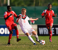 Bryce Alderson (8) of Canada clears the ball away from Alexander Gonzalez (20) of Panama during the semifinals of the CONCACAF Men's Under 17 Championship at Catherine Hall Stadium in Montego Bay, Jamaica. Canada defeated Panama, 1-0.