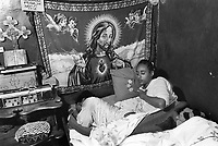 Ethiopia. Addis Ababa is the capital city and the name of a region of Ethiopia. Ingudai, 15 years old, is a member of the Circus Ethiopia. She wakes up early morning at home while her sister is sill sleeping in the same bed. A carpet with a representation of two couples of angels and Jesus Christ, and an orthodox cross are fixed on the wall. Circus Ethiopia was legally established in 1991 with a view to introduce circus art in Ethiopia. Ever since its creation Circus Ethiopia has given new dimension to  circus art in Ethiopia but as well internationally. By blending the art with the Ethiopian traditional costume, music and dance, Circus Ethiopia with its associative approach has inspired many circuses to grow throughout Ethiopia. © 1996  Didier Ruef