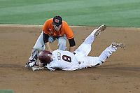 Shortstop Marcus Mooney (8) of the South Carolina Gamecocks is out at second after trying to stretch a single into a double in an NCAA Division I Baseball Regional Tournament game against the Campbell Camels on Friday, May 30, 2014, at Carolina Stadium in Columbia, South Carolina. South Carolina won, 5-2. (Tom Priddy/Four Seam Images)