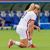 TOKYO, JAPAN - JULY 22: Lindsey Horan #9 of the United States takes the knee before a game between Sweden and USWNT at Tokyo Stadium on July 22, 2021 in Tokyo, Japan.