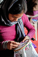 Dehradun, Uttarakhand, India.  Young Indian Woman Embroidering.