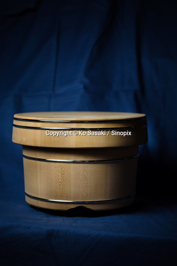 Wooden container of keeping cooked rice called ohitsu, made by Eifu Kawamata of Okeei
