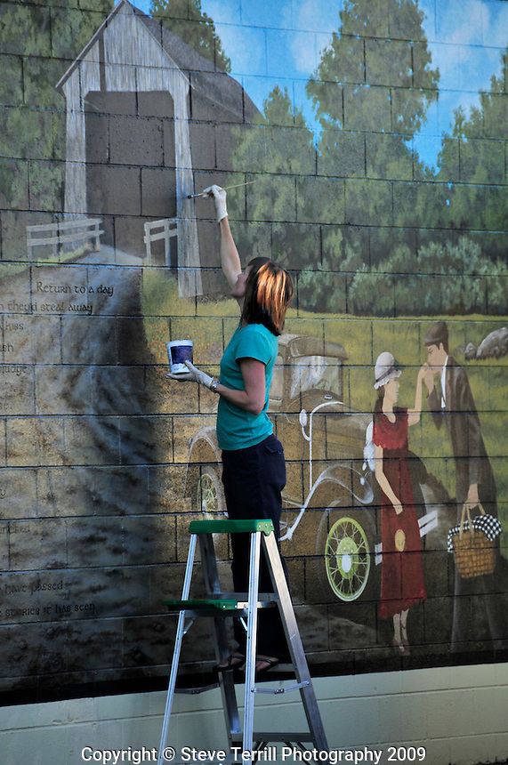 Touching up mural in Silverton, Oregon