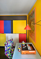 The small study bedroom is decorated in Mondrian colours, bright and primary