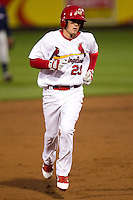 Ryan Jackson (23) of the Springfield Cardinals heads toward third base during a game against the Northwest Arkansas Naturals on May 13, 2011 at Hammons Field in Springfield, Missouri.  Photo By David Welker/Four Seam Images.